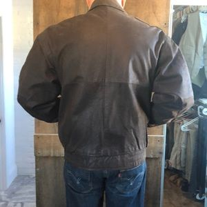 Fantastic leather jacket by CONTEXT . Brown
